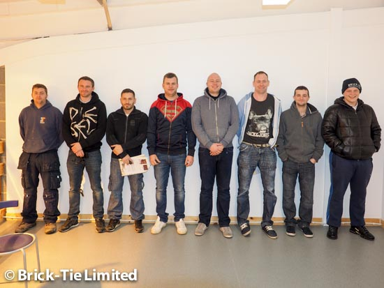 eight of the wall tie and structural repair team line up