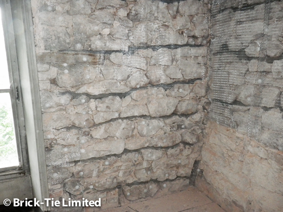 Mesh applied before replastering the repaired walls