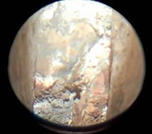Boroscope view of rusty wall tie