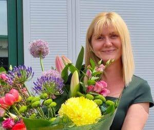 Katrina Jackson with flowers