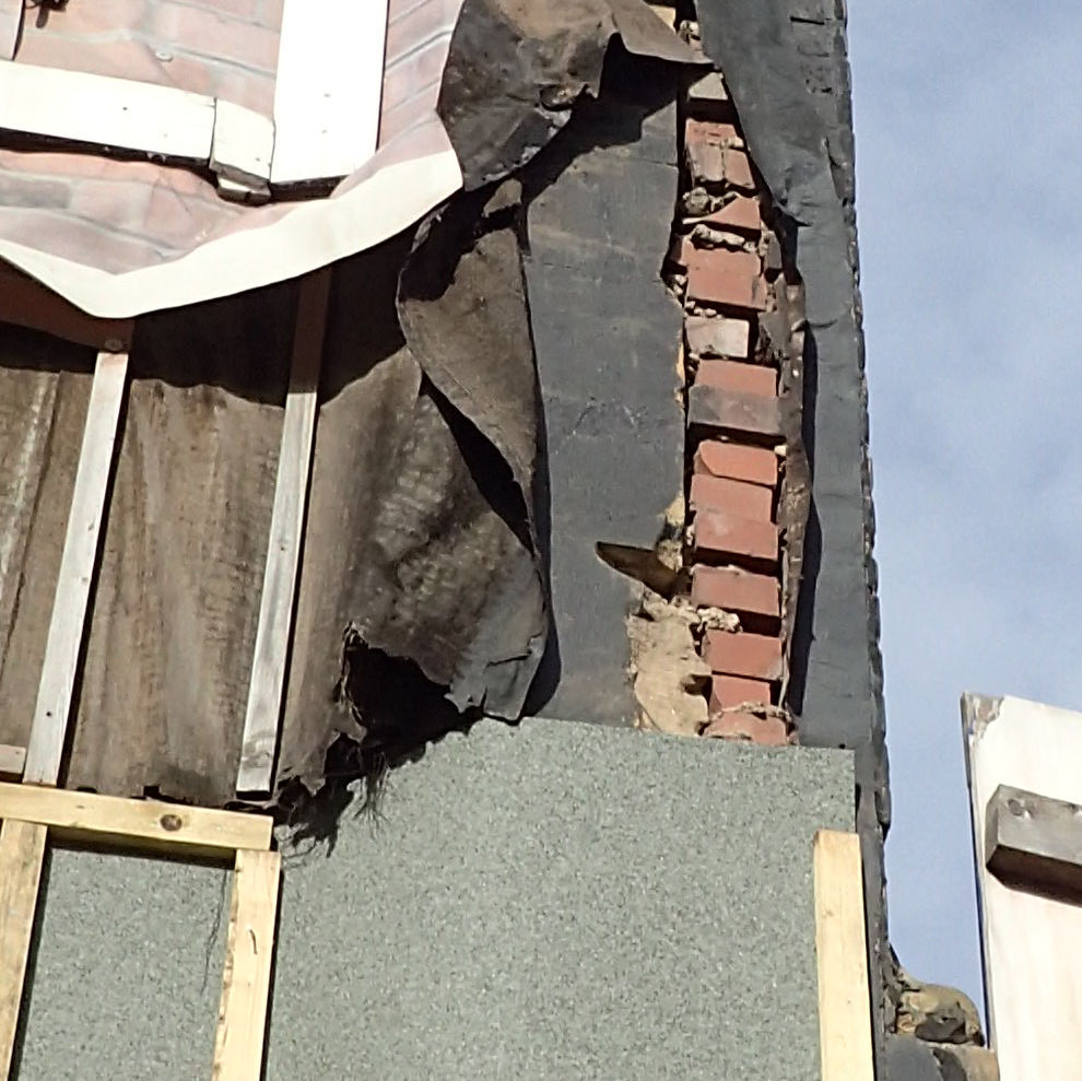 Signs of hidden defects in a facade in Leeds